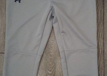 Dámske 3/4 športové nohavice Under Armour XS