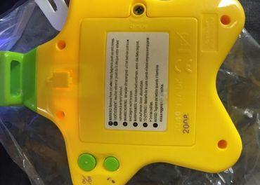 TOMY Projektor s melódiami hviezdička žltá